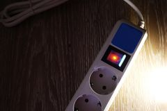 Electric surge protector Close-up and power supply details stock images