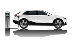 Electric SUV with charging station. royalty free stock photography