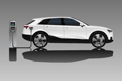 Electric SUV with charging station. stock image