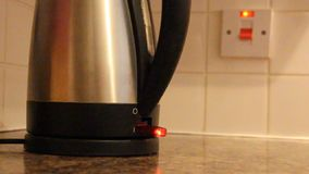 Electric switch boiling kettle stock video footage