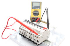 Electric switch on the control panel and multimeter Stock Photo