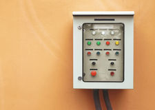 Electric switch control panel. On orange wall royalty free stock images