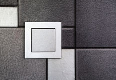 Electric switch. Electrical wall switch inside the house. on wallpaper background. device Stock Photo