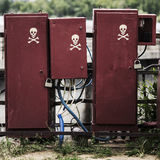 Electric switches in old dirty boxes with the symbols Skull Royalty Free Stock Photo