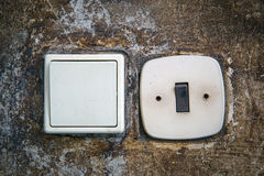 Electric switches on wall Stock Photography