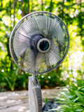 The  electric table fan in the garden Stock Photography