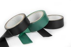 Electric tapes black and green on the white. Electric tapes black and green on the white Royalty Free Stock Images