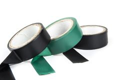 Electric tapes black and green on the white. Electric tapes black and green on the white Stock Image