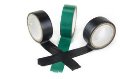 Electric tapes black and green on the white. Electric tapes black and green on the white Royalty Free Stock Photos