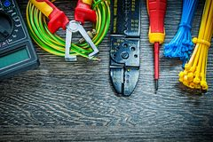 Electric tester screwdriver rolled cable ties insulation strippe. Rs on wood board stock images