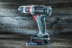 Free Electric Tools Cordless Hand Drill On Vintage Wooden Background Royalty Free Stock Photography - 171756827