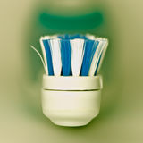 Electric toothbrush. On blurred background Royalty Free Stock Images