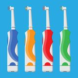 Electric toothbrush in different colors. Royalty Free Stock Photo