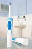 Electric toothbrush and toothpaste Stock Image