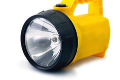 Electric Torch. In the yellow plastic case with  light shadow. Image is isolated on white and the file includes a clipping path Royalty Free Stock Photo