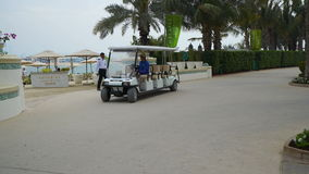 Electric tourist car goes  on the hotel stock video