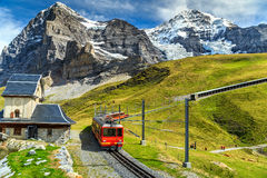 Free Electric Tourist Train And Eiger North Face,Bernese Oberland,Switzerland Stock Photography - 71126222