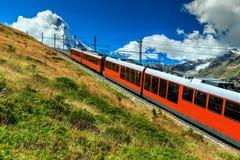 Electric tourist train and famous misty Matterhorn peak,Switzerland,Europe Stock Photos