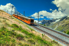 Electric tourist train and Matterhorn peak near Zermatt, Switzerland, Europe Royalty Free Stock Image