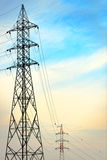 Electric tower against blue sky Royalty Free Stock Images