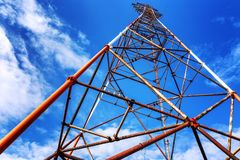 Electric tower against the bright blue sky. Horizontal stock image