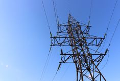 Electric tower on blue sky stock photos