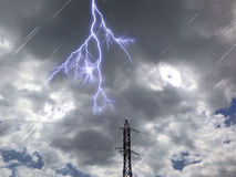 Electric tower in clouds dark day Royalty Free Stock Image