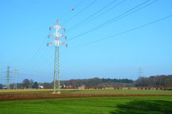 Electric tower on a field Royalty Free Stock Photo