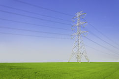 Electric tower on green field Royalty Free Stock Photos