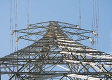 Electric distribution tower, looking up at the tower royalty free stock image