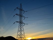 Electric tower at sunrise Stock Images