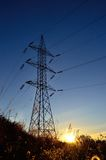 Electric tower at sunrise Stock Image
