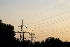 Electric tower at sunset Royalty Free Stock Images