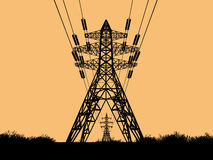 Electric Towers. A beautiful view of a line of silhouetted electric towers, on a twilight sky Royalty Free Stock Image