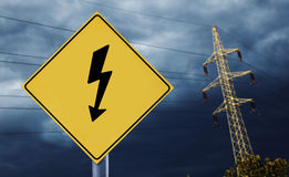 Electric towers with electricity label Stock Image