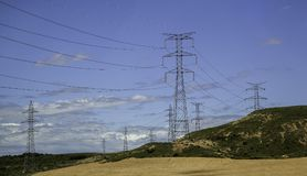 Electric towers in a landscape. Detail of electric power transport Stock Photo