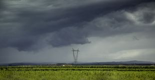 Electric towers in a landscape. Detail of electric power transport Royalty Free Stock Photos