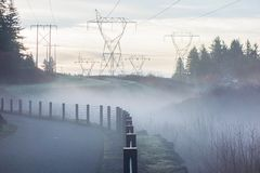 Electric Towers Under Foggy Weather Royalty Free Stock Photo