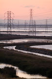 Electric towers on water Stock Photo