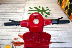 Electric toys in the playground. Detail of a red motorbike in the amusement park Stock Photos