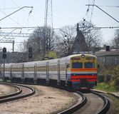 Electric train. With cars on abrupt turn Royalty Free Stock Photos