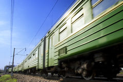 Electric train. The train on the railway passes past Royalty Free Stock Photos