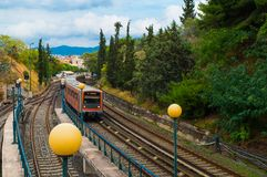 The electric train in the area of Thiseio in Athens, Greece. The oldest urban rapid transit system of Athens metropolitan area in Greece stock image
