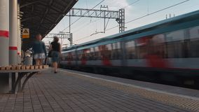 Electric train arriving stock footage