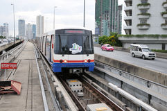 Electric Train in Bangkok. BANGKOK - JUNE 7: BTS Skytrain on rail alongside Sathon Road as the BTS network celebrates its 10th anniversary of operations in the Stock Photo