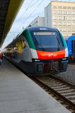 Electric train of business class of company Stadler, Minsk, Bela. MINSK, BELARUS - OCTOBER 1, 2016: Unidentified people are waiting to board in electric train of Royalty Free Stock Photos