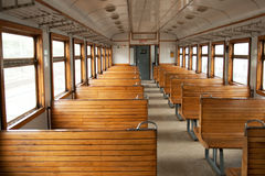 The electric train car inside. The car of an electric train with wooden seats Royalty Free Stock Photography