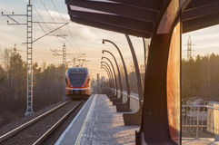 Electric train departure from small railroad station Royalty Free Stock Photo