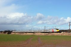 Electric train on ECML with new Virgin branding Royalty Free Stock Photos