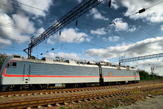 Electric train and electric infrastructure. Under the dark blue sky Royalty Free Stock Photos